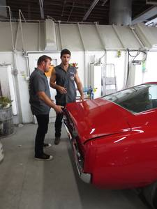 Billy Derian Sr. and Billy Derian Jr. discuss the outcome of the '67 Ford Mustang.